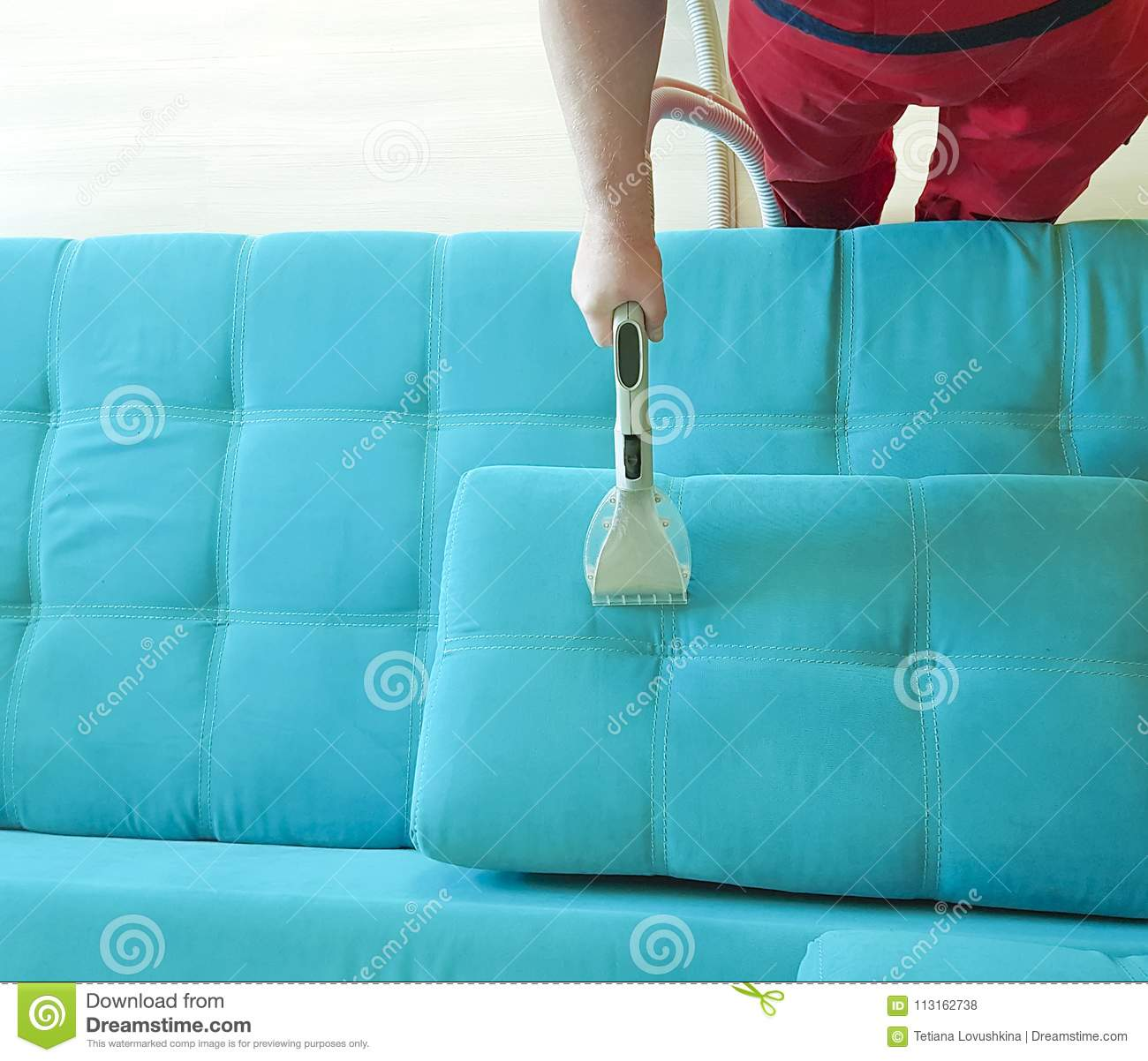 Man Vacuuming Sofa View From Above Stock Photo Image Of Floor