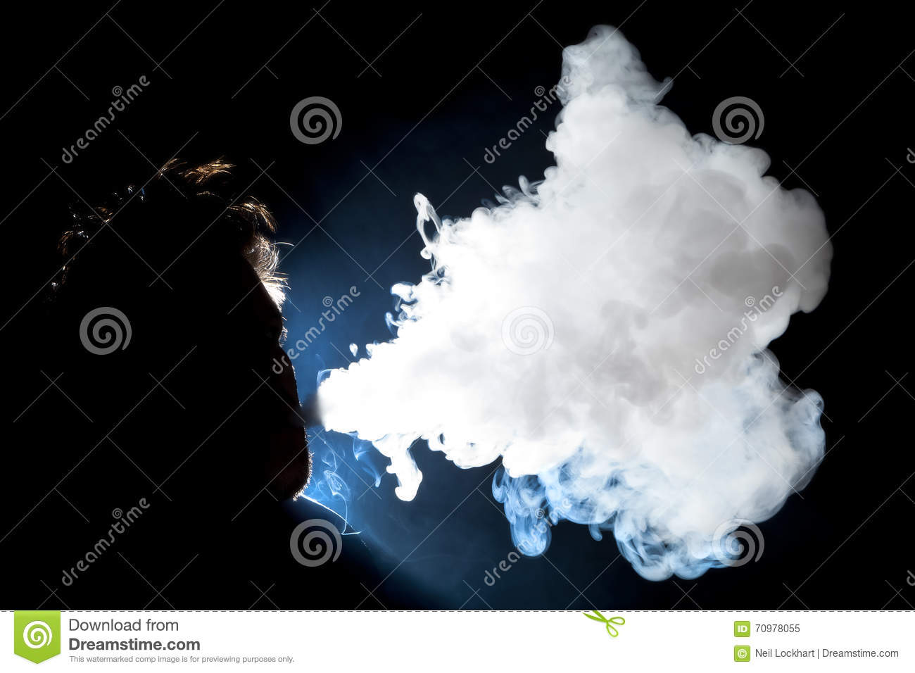 man vaping and blowing cloud stock photo image 70978055
