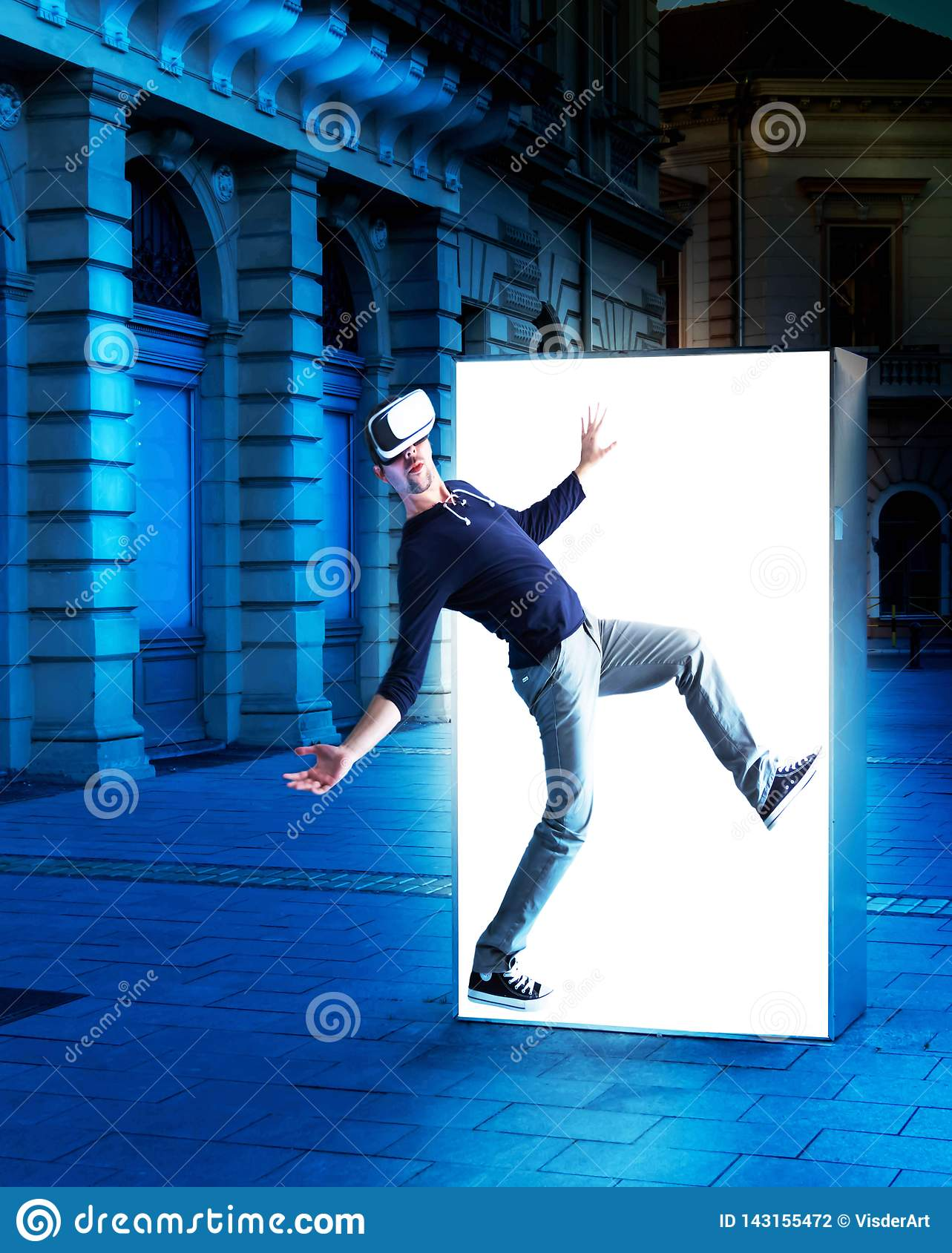 Man in virtual reality glasses coming out of a street poster