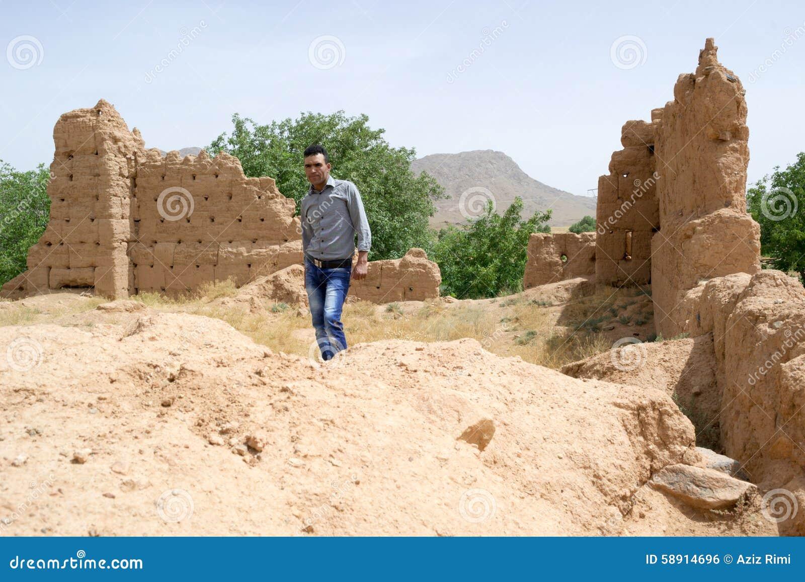 Man visiting a historical ruins site