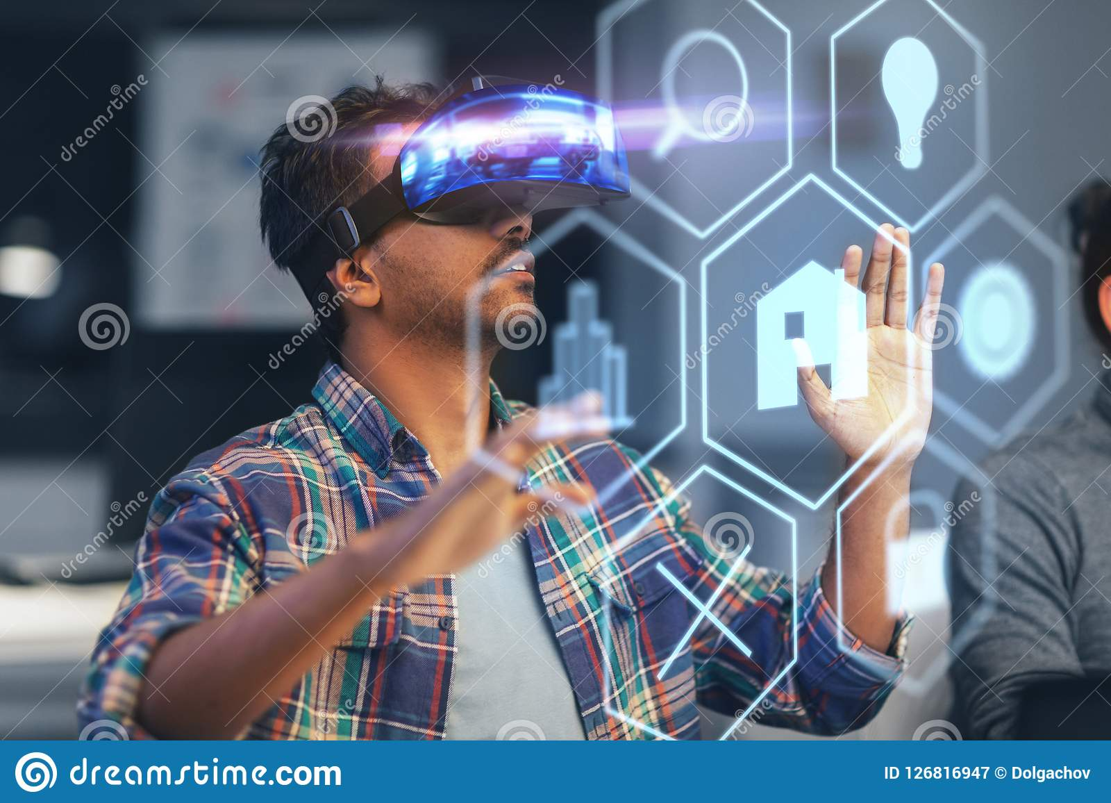 Man in vr headset with virtual interface at office. Deadline, augmented reality and technology concept - creative man with virtual headset or vr glasses and Royalty Free Stock Photography