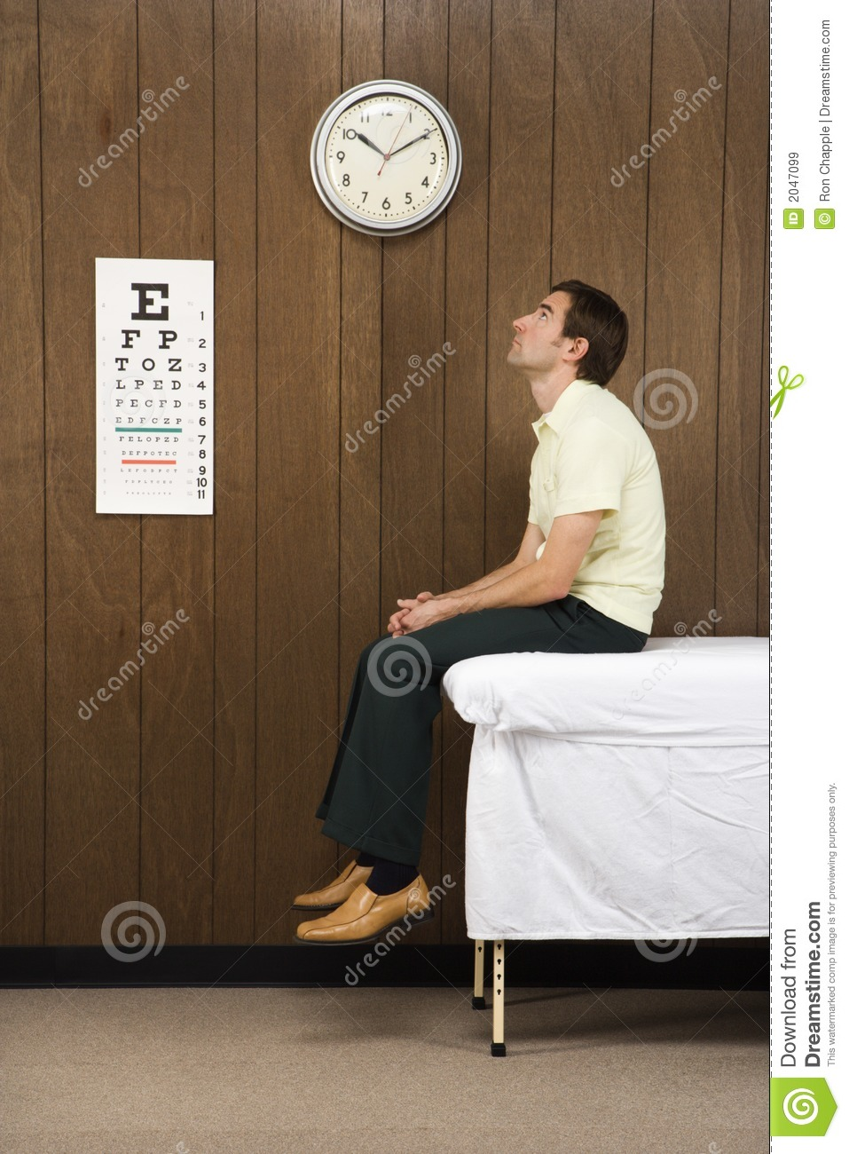 Man Waiting In Retro Doctor S Office Royalty Free Stock