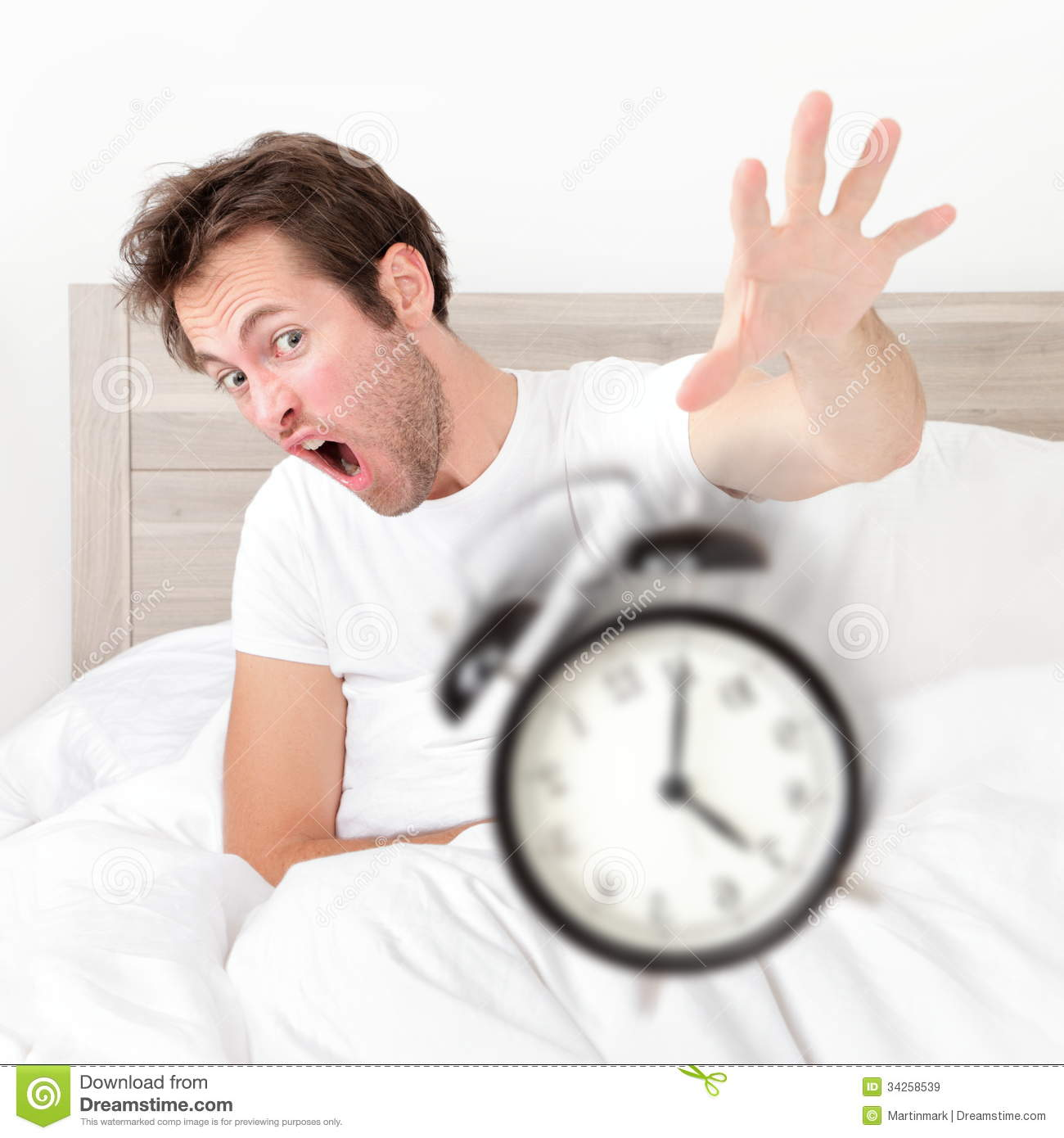 Man Waking Up Late For Work Early Throwing Alarm Stock Image