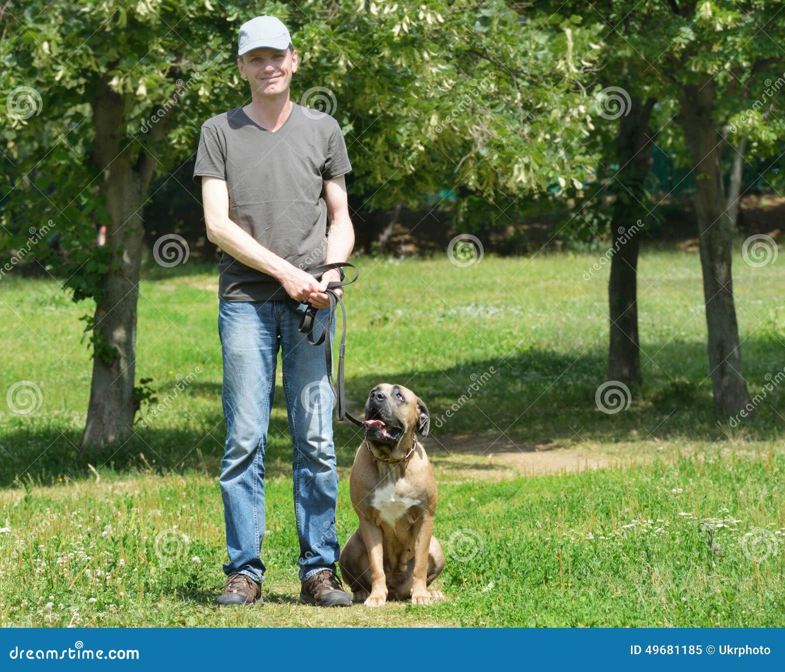 Man Walking Dog : Man walking with his dog stock photo image