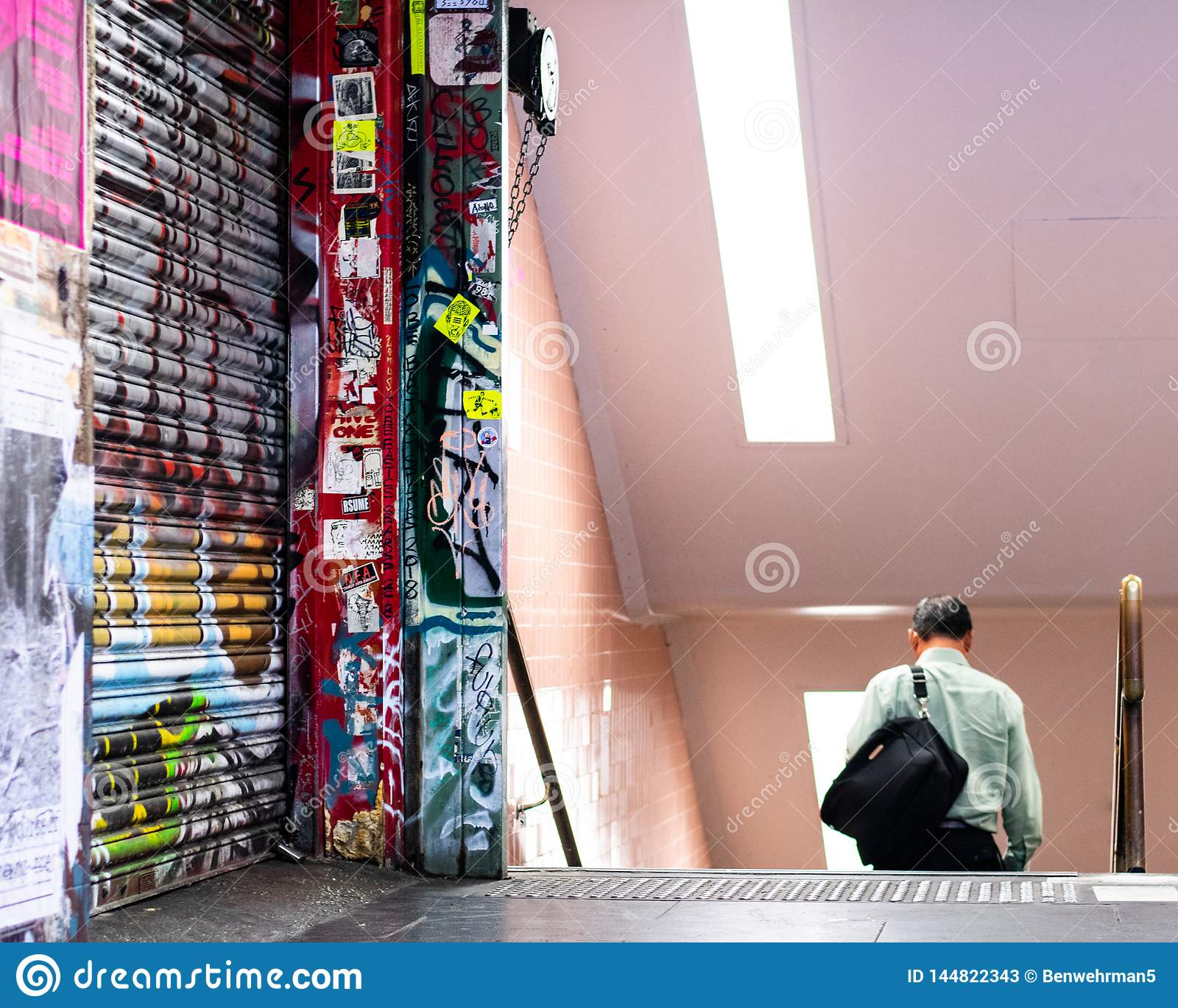 Man Walking into Underground Subway Station