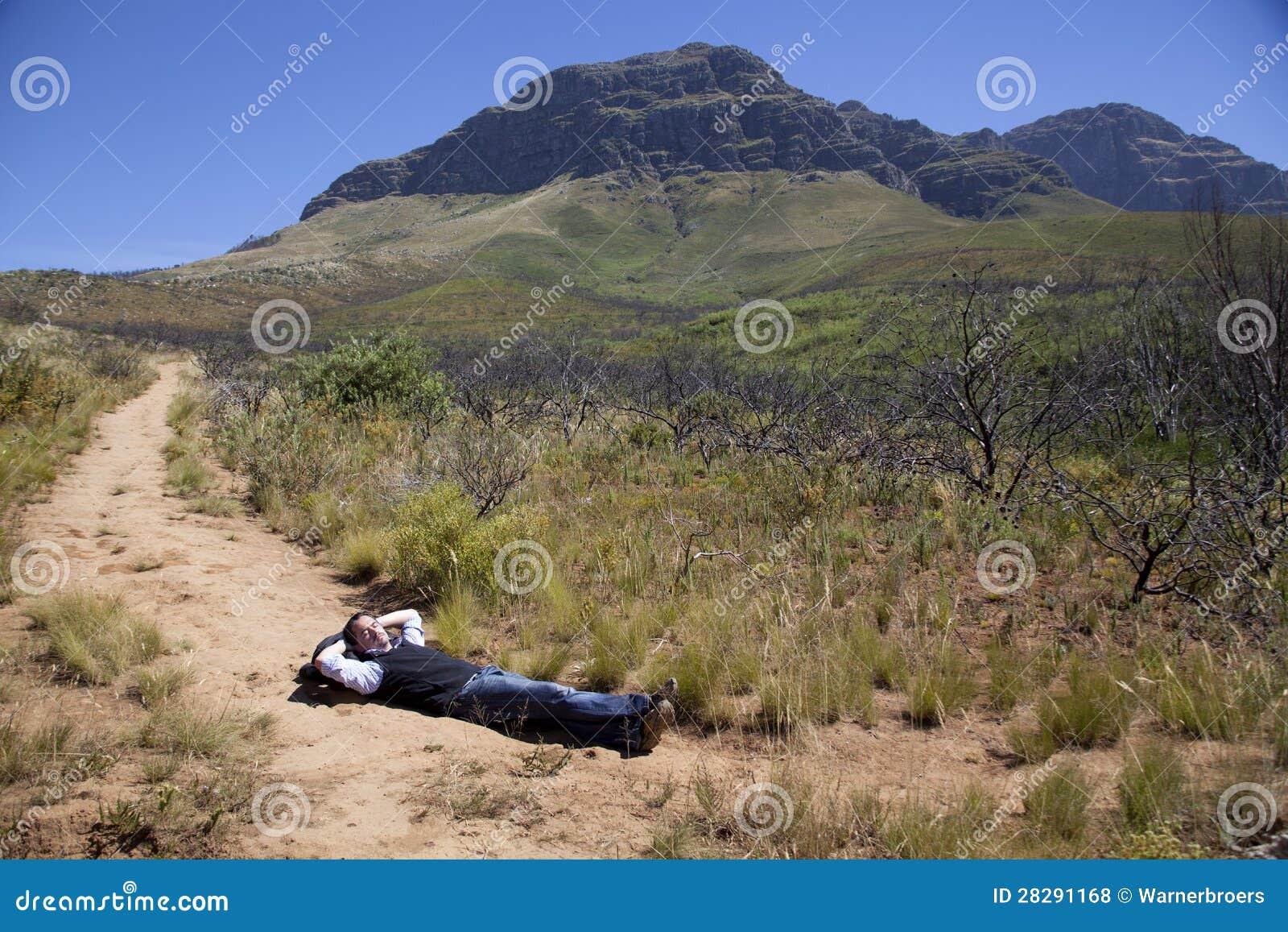 Man Walking Up A Mountain Royalty Free Stock Photos