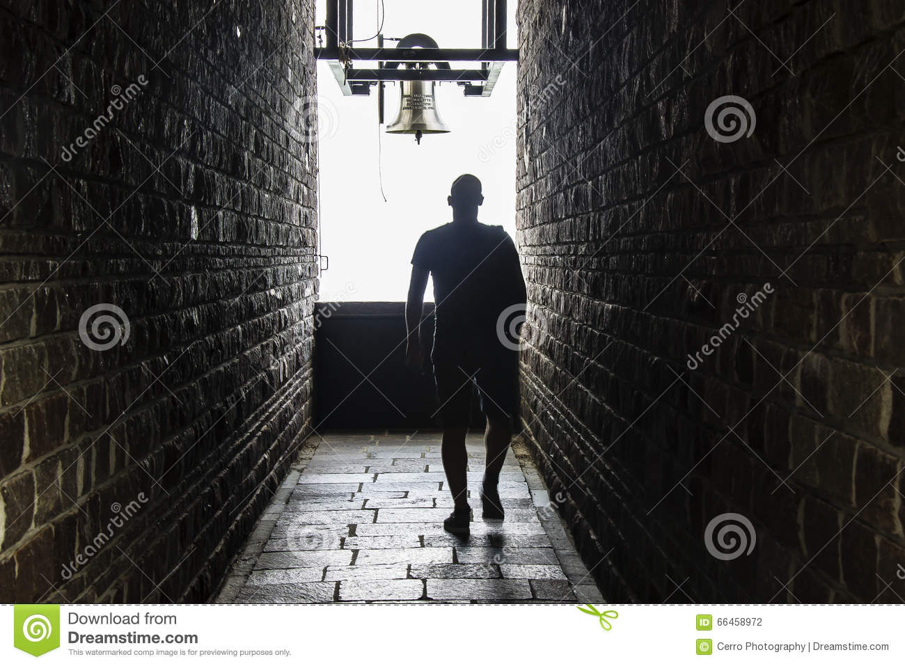 A men walks into a dark tunnel, but a light shows at the end