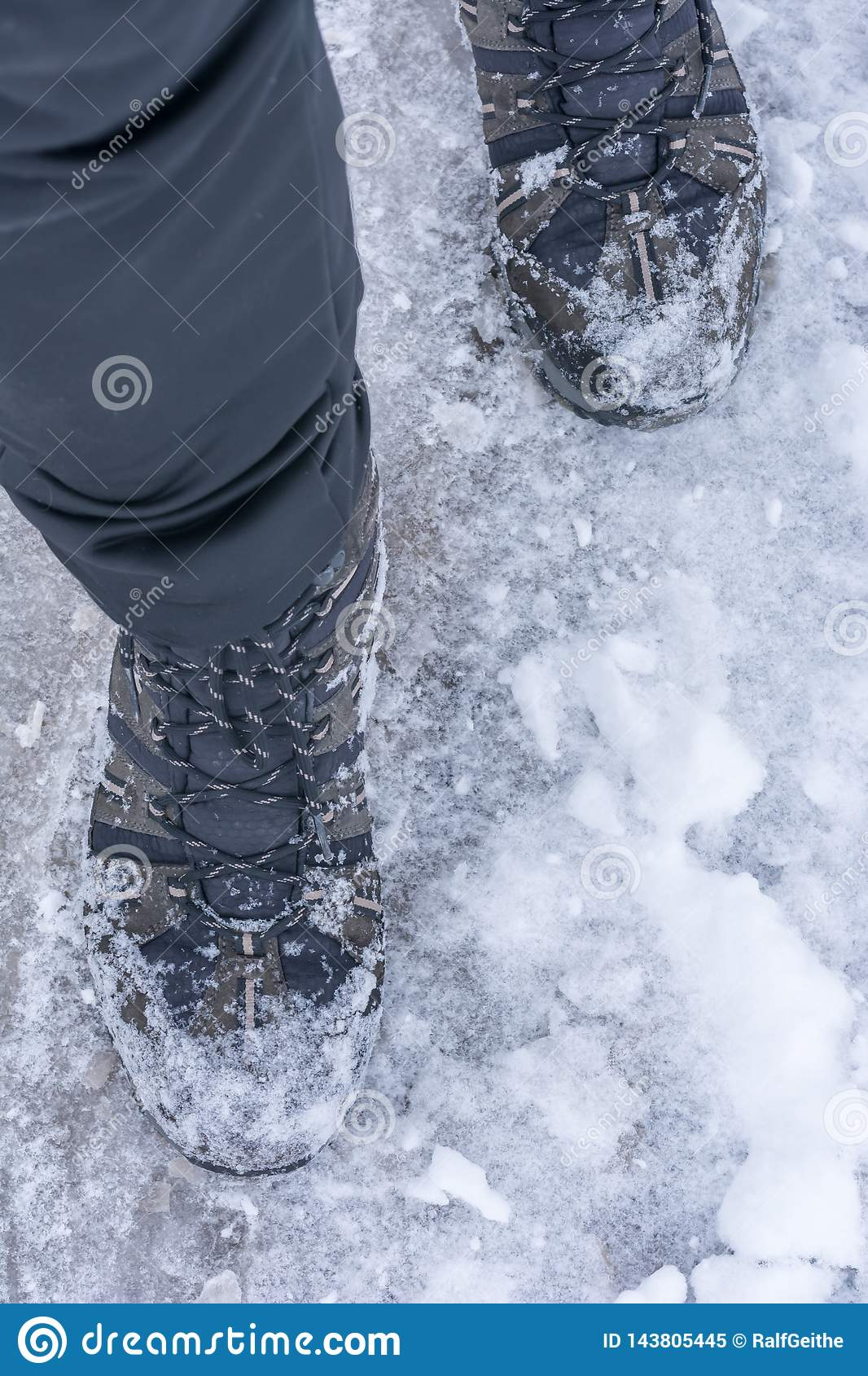 Man goes through the snow with warm winter boots