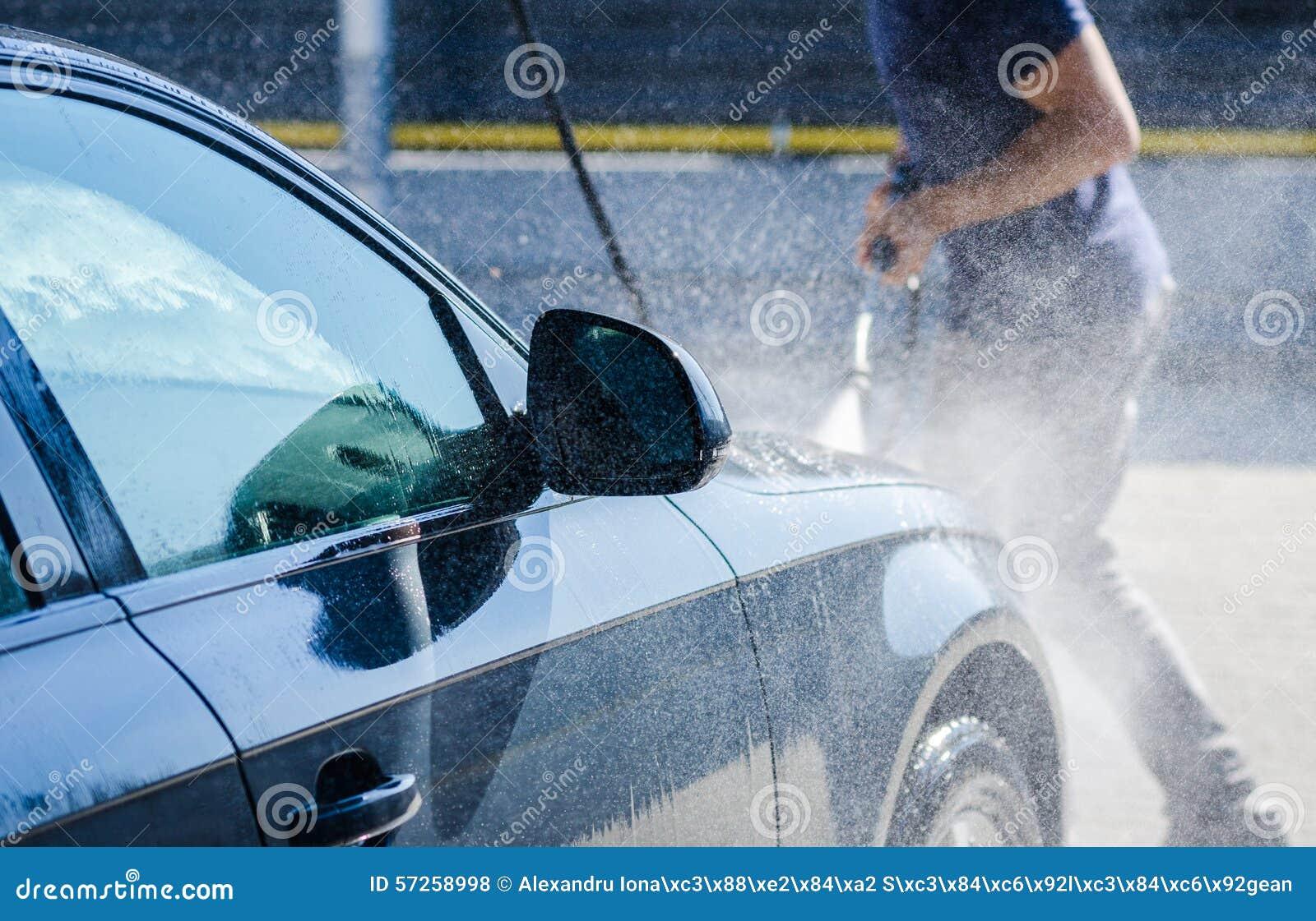 Man washing a car at the carwash