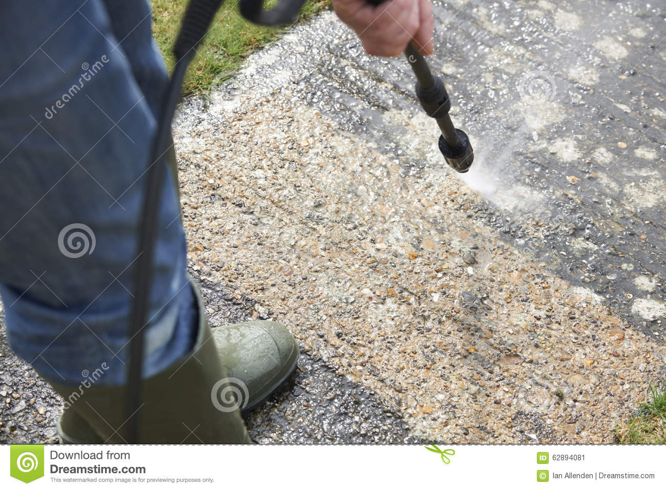 Man washing concrete path with pressure washer stock photo for Cleaning concrete paths