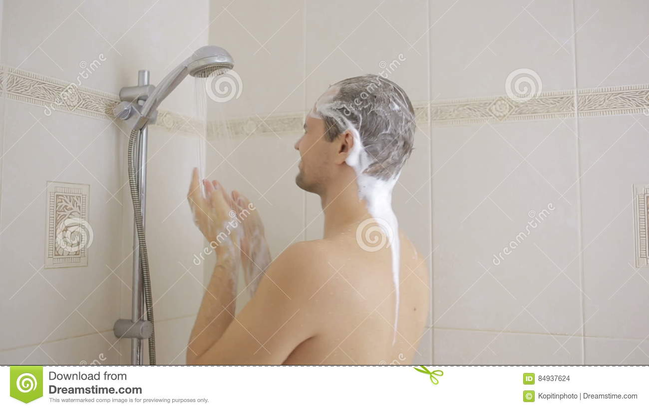 Man Washing Hair With Shampoo In The Shower. Bathroom. Stock Footage ...