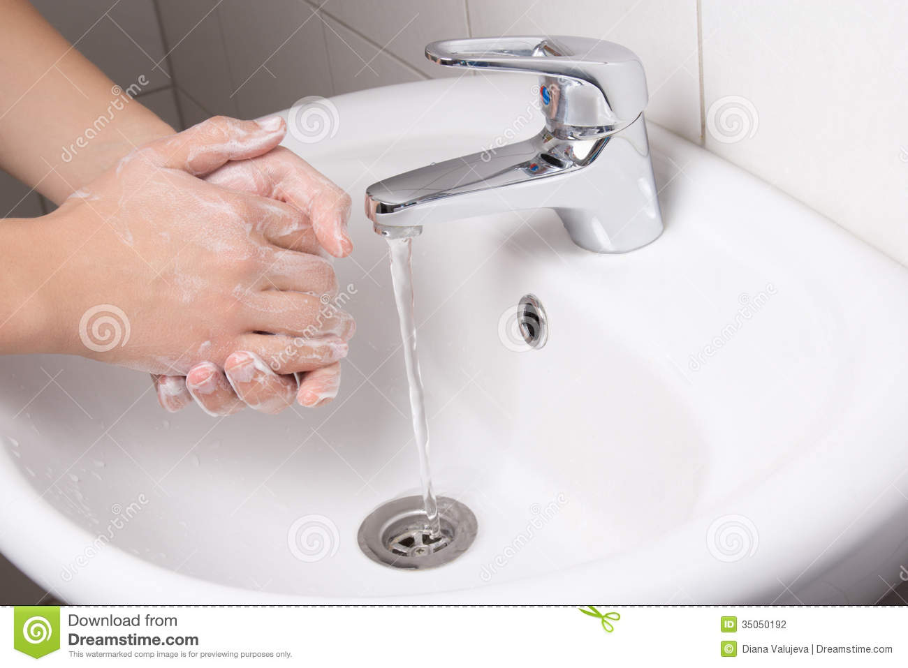 Man Washing His Hands In Bathroom Sink Stock Photography