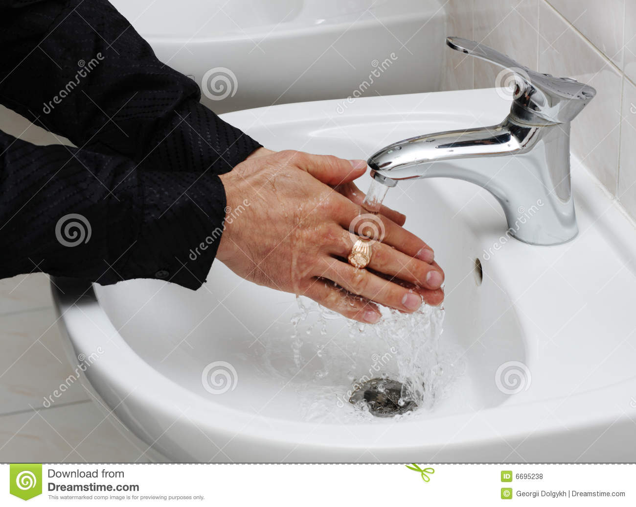 Man Washing His Hands Under Running Water Royalty Free