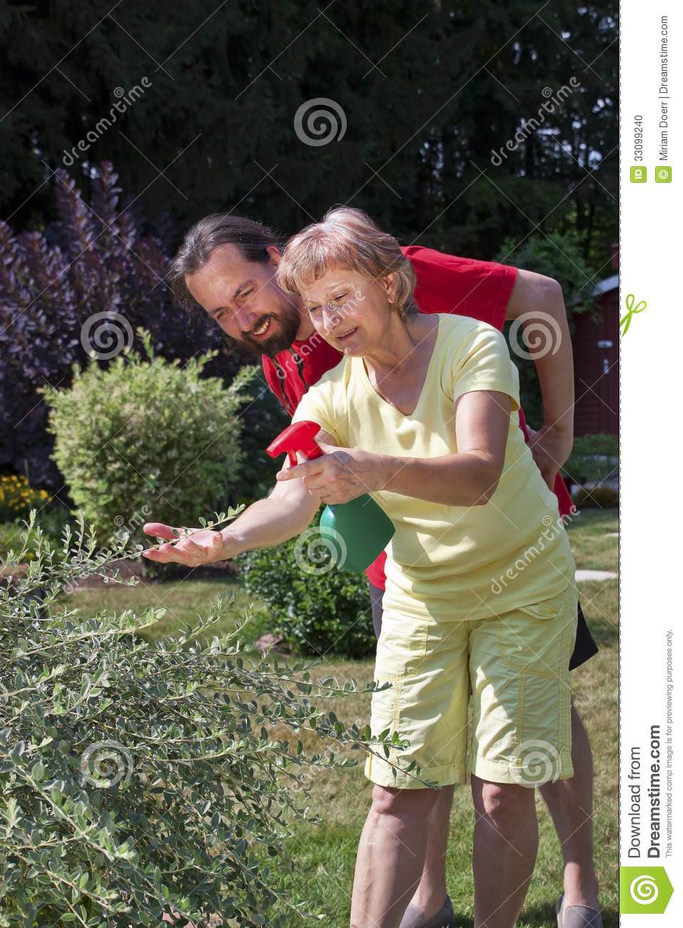 Man watches woman at gardening