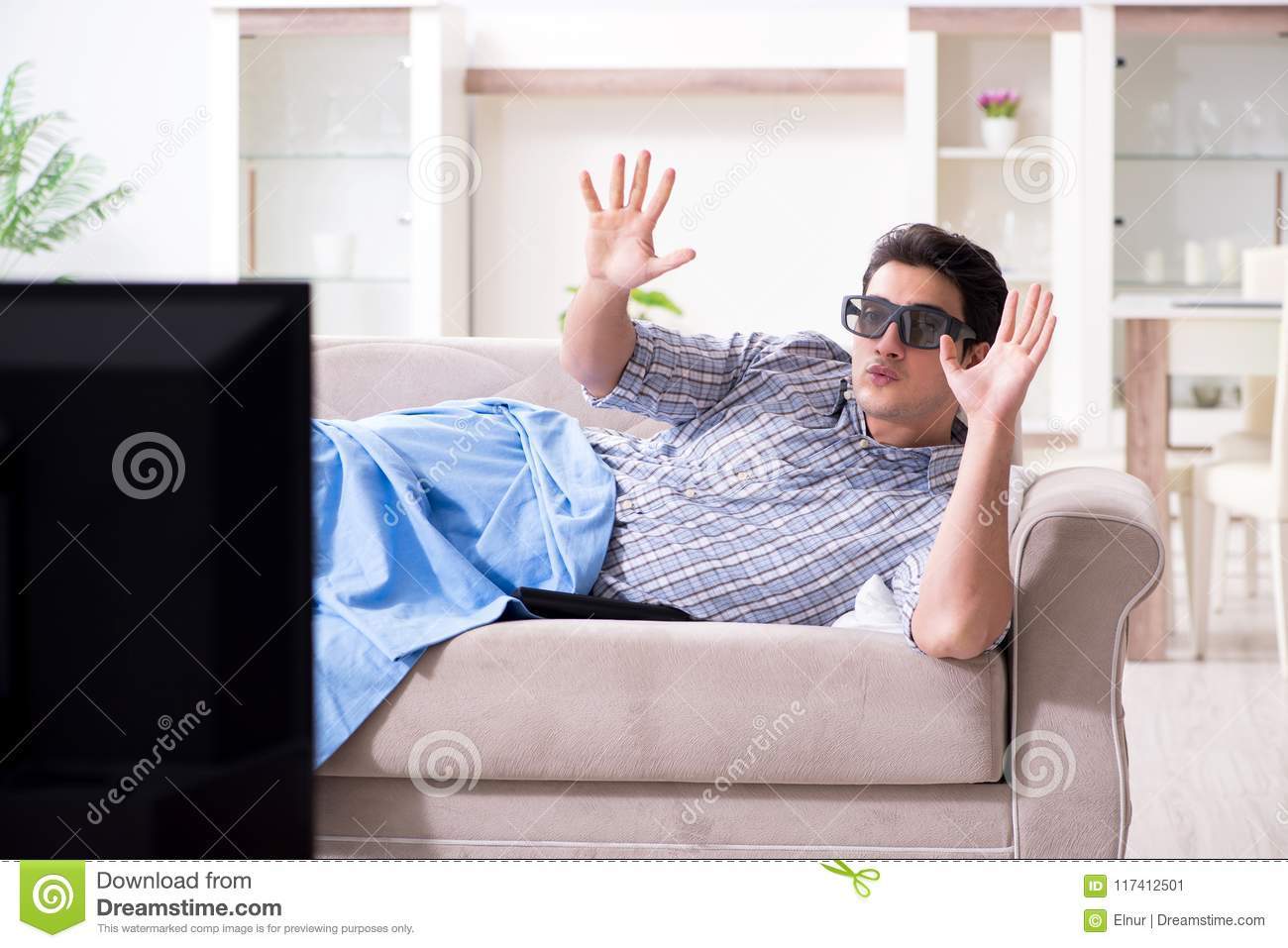 The man watching 3d tv at home
