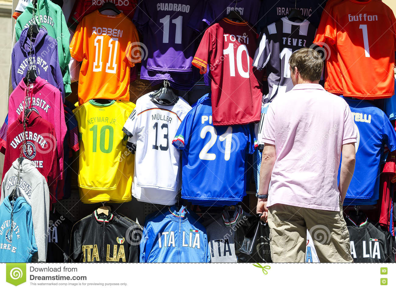 best service 66e04 6668d Man Watching Football Shirts On Display Editorial Stock ...