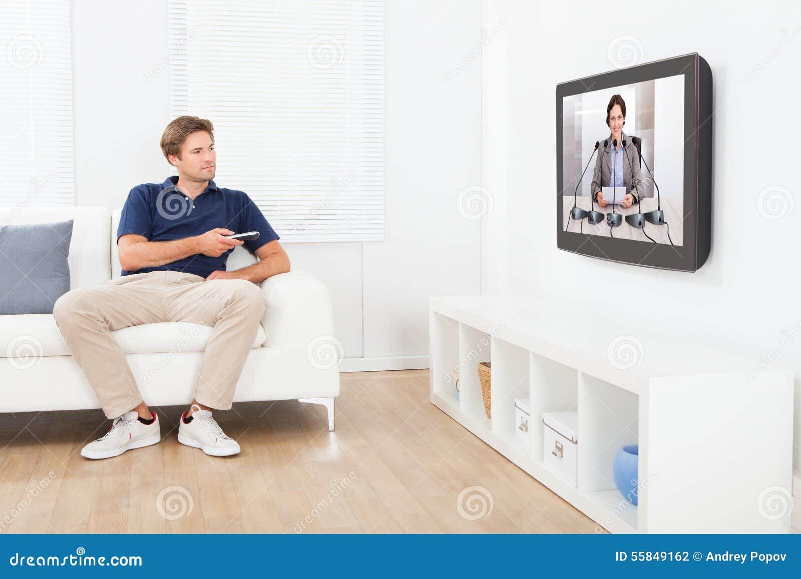 Man Watching News On Tv At Home Stock Photo Image Of Caucasian  # Meuble Tv Nesx