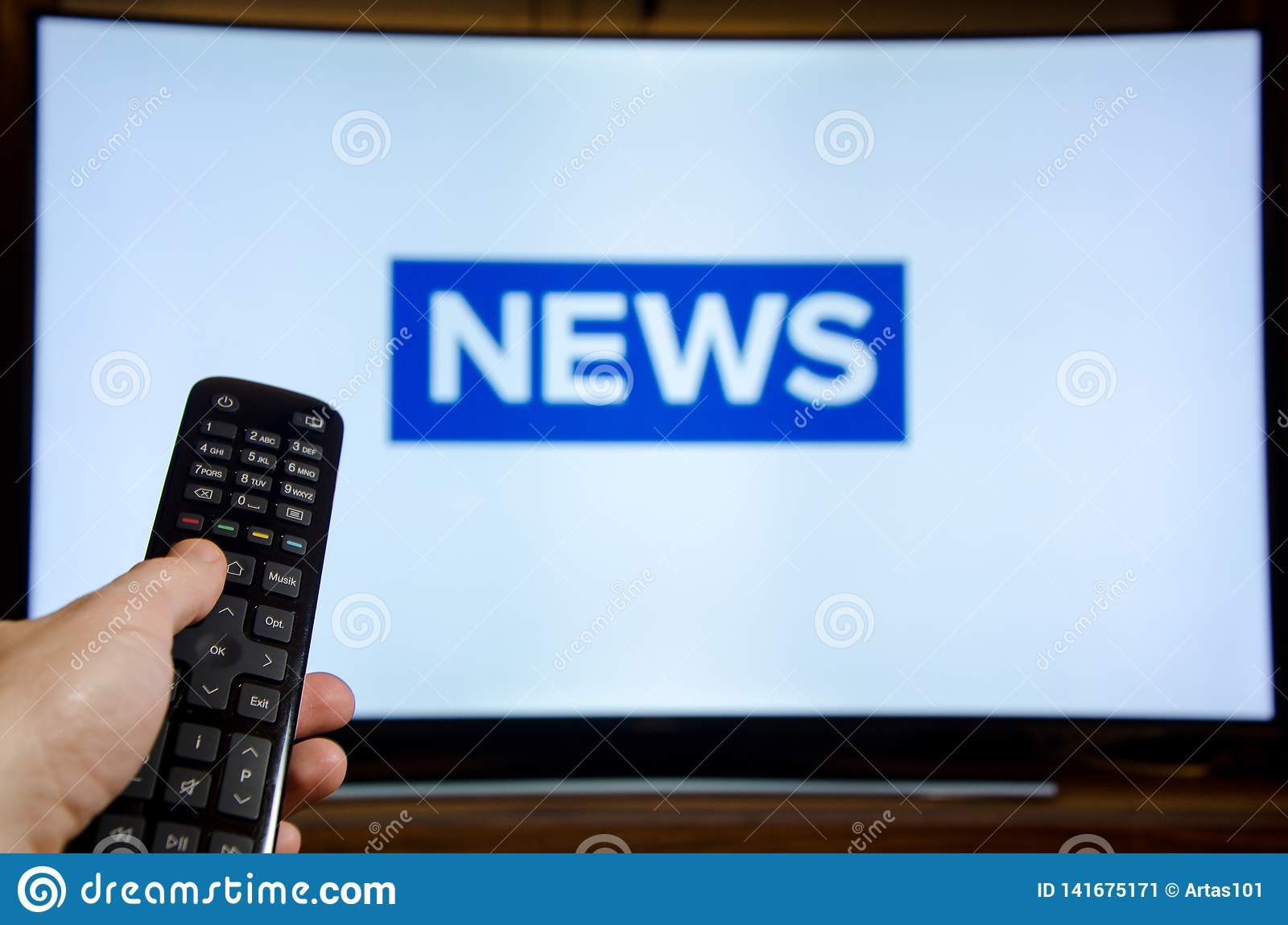 Man watching News on TV and using remote controller