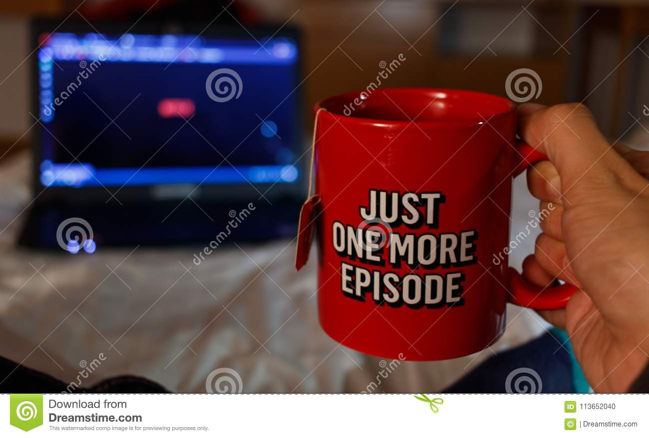 Man Watching series while holding with a cup of tea with netfix