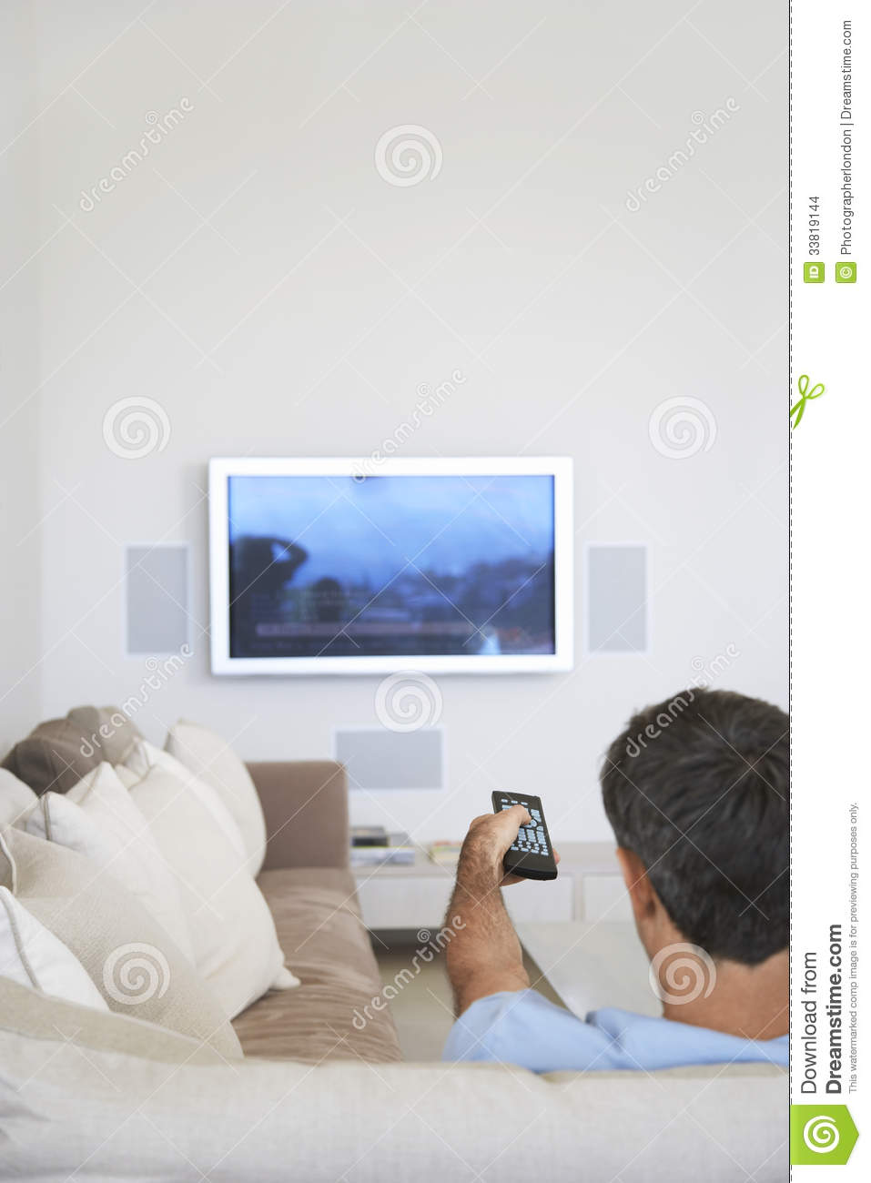Man Watching Television In Living Room Stock Images