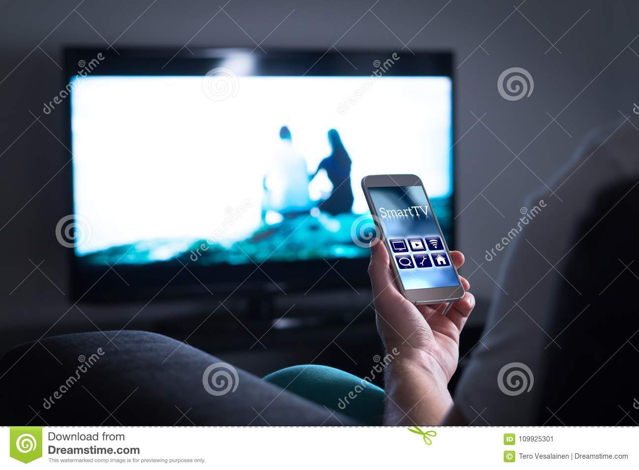 Man Watching Television And Using Smart Tv Remote Control App  Stock