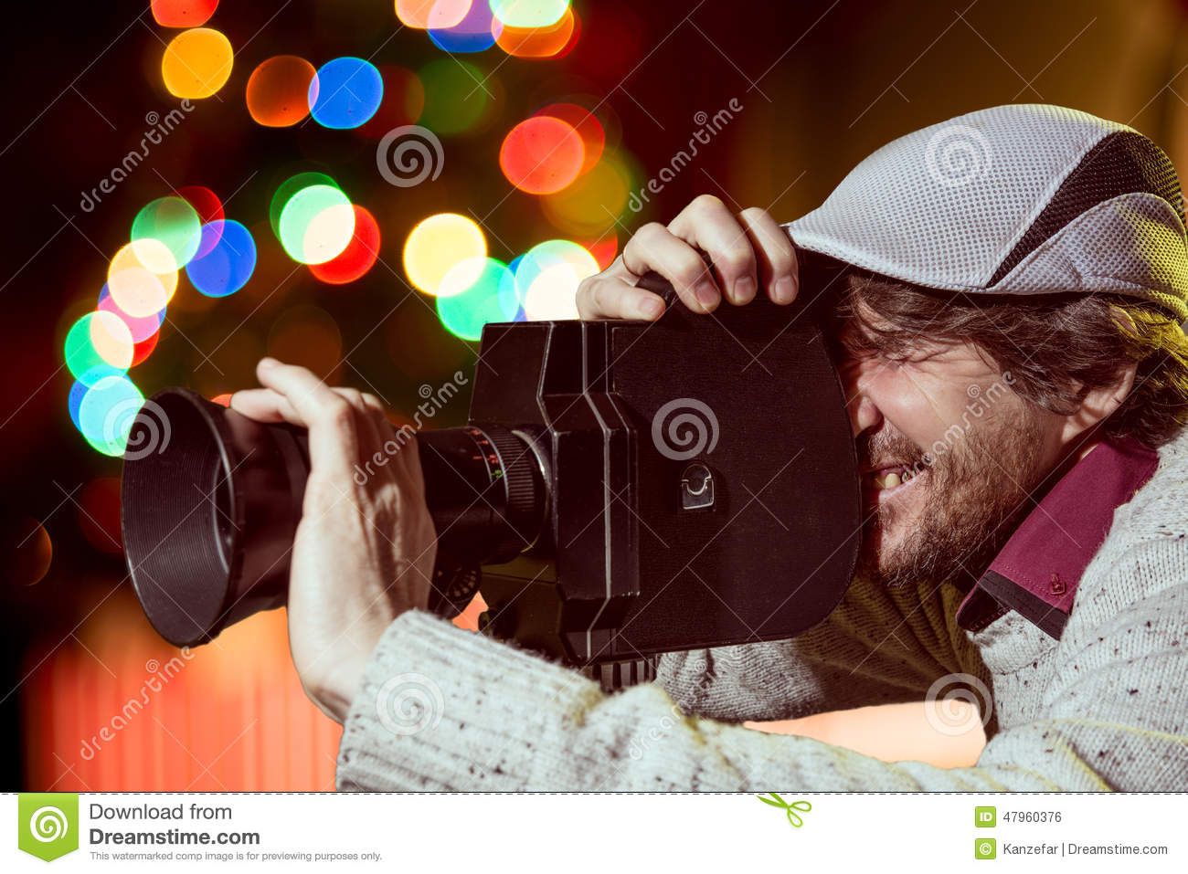 A Man Wearing A Cap With An Old Movie Camera Stock Photo - Image of ...