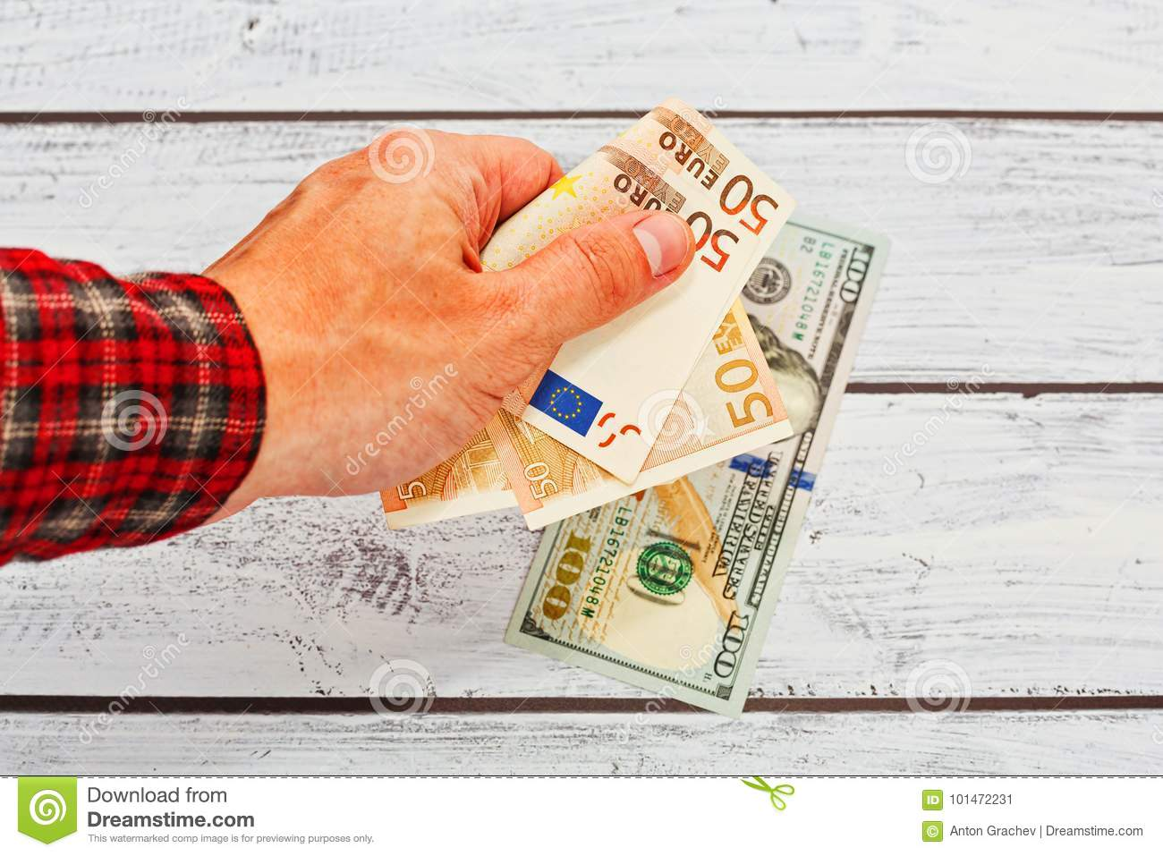 Male person exhange euro to US dollars
