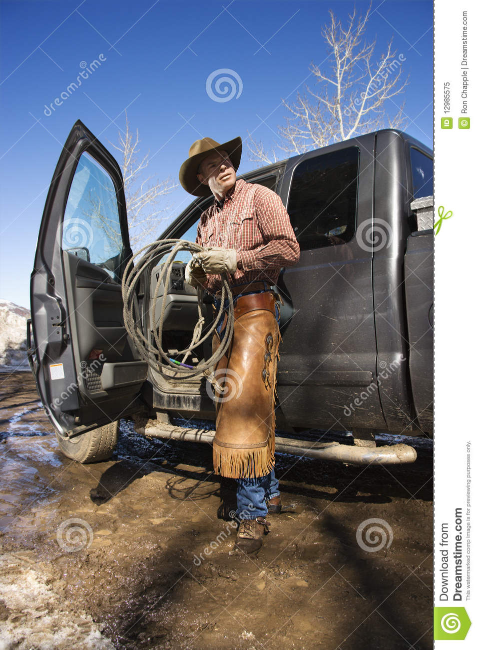 6 Door Truck >> Man Wearing Cowboy Hat With Lariat And Truck Stock Image - Image: 12985575