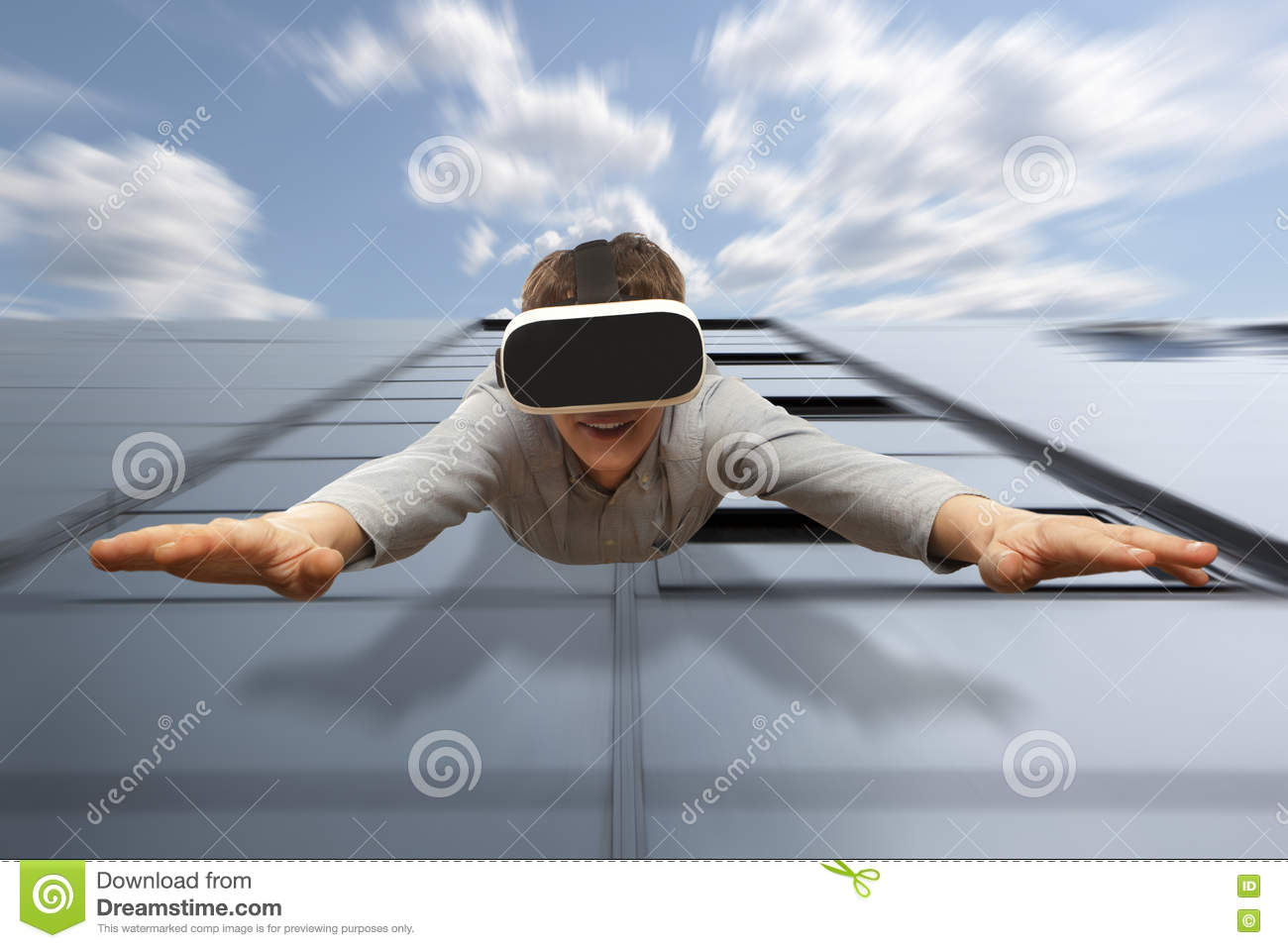 Man wearing virtual reality glasses flying from a skyscraper