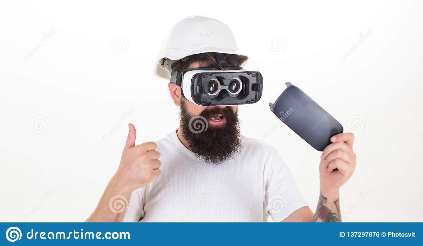 Man wearing virtual reality goggles. Man wearing virtual reality goggles in white background. Virtual reality.