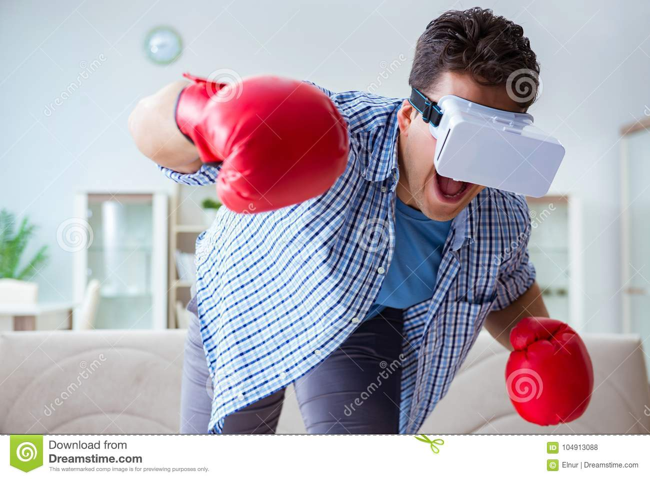 6272f39bfa88 The Man Wearing Virtual Reality Vr Glasses Playing Boxing Game Stock ...