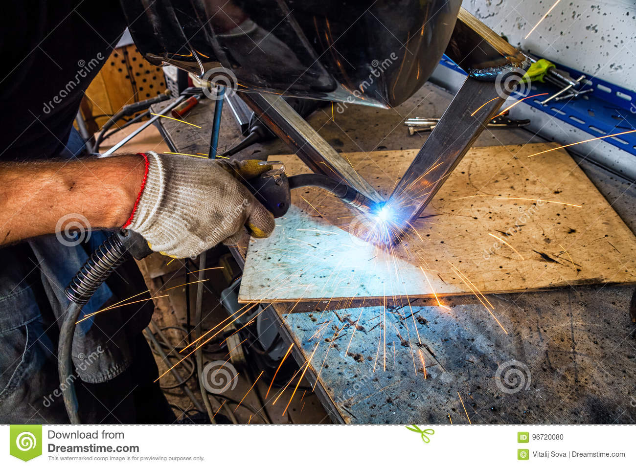 Man Welds With A Welding Machine Stock Photo - Image of