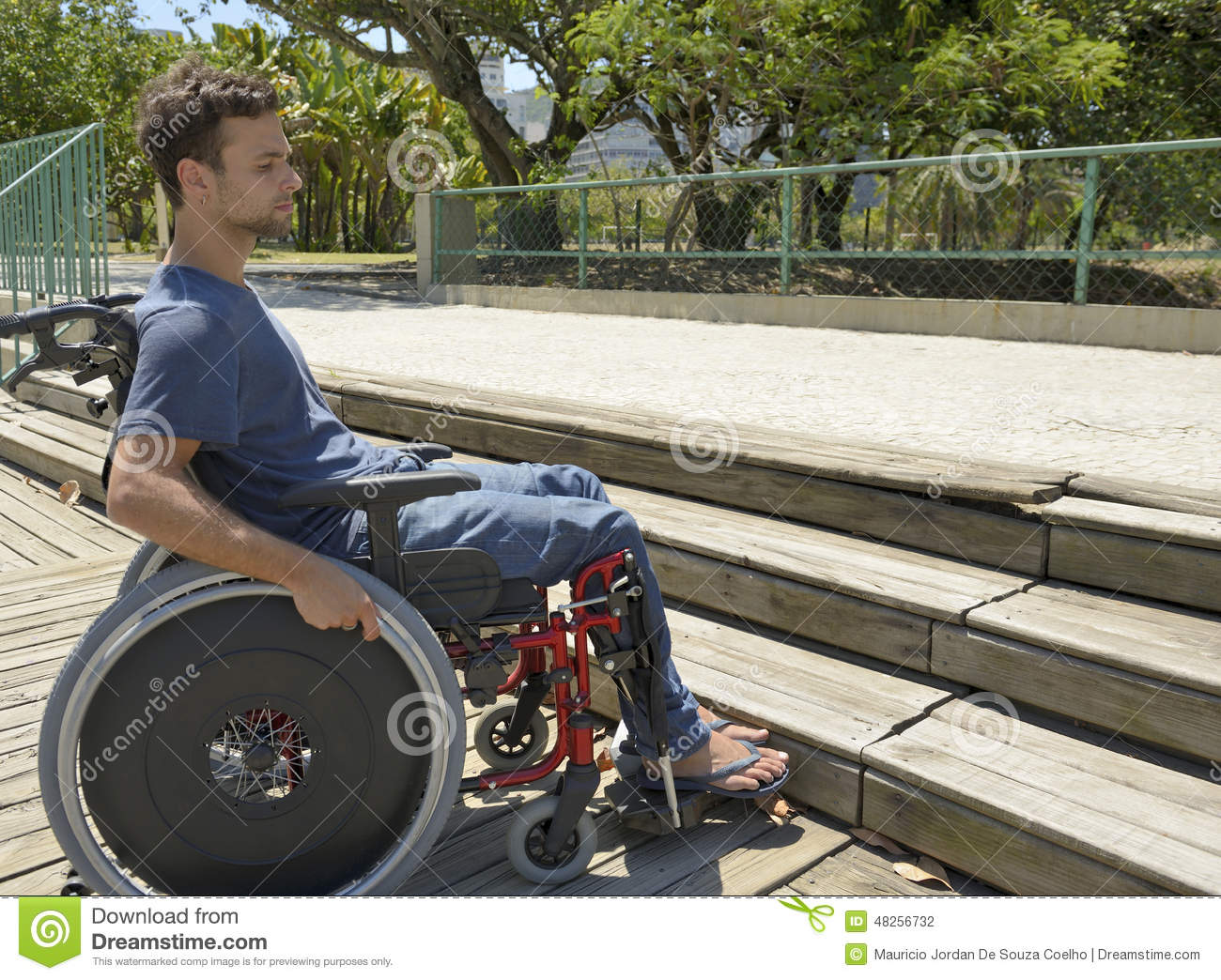 Man In Wheelchair In Front Of Stairs Stock Photo Image