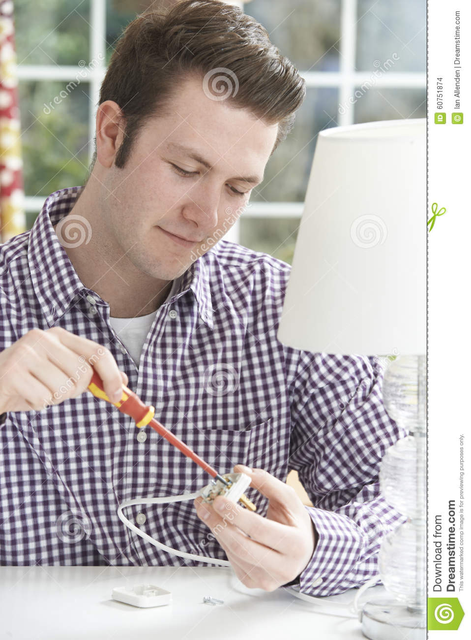 Man Wiring Electrical Plug On Lamp At Home Stock Photo Image Of Download Fuse