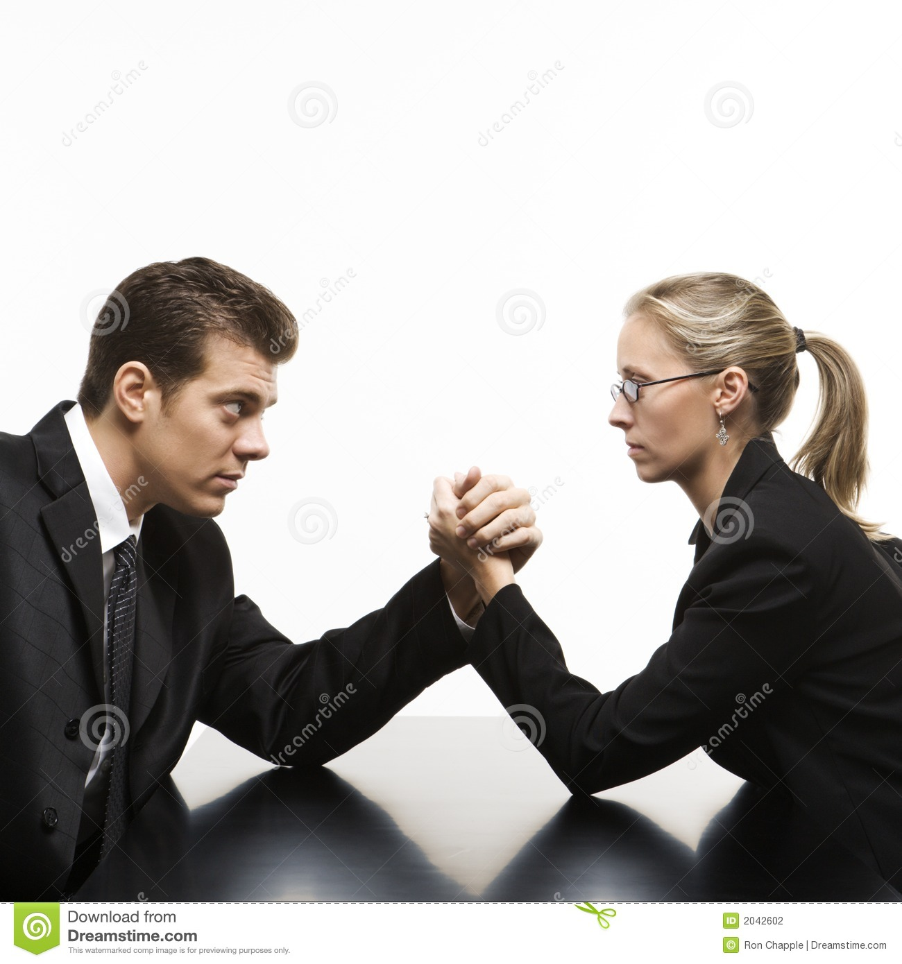 Man And Woman Arm Wrestling On Table. Stock Photography - Image ...
