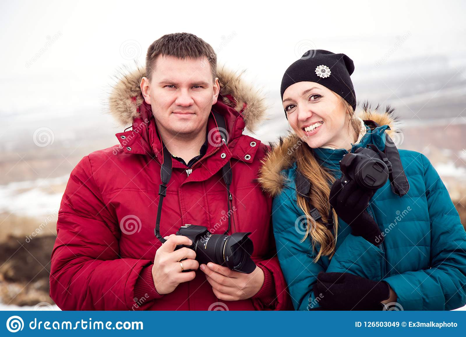 A Man And A Woman With Cameras Travel In Winter Stock Image