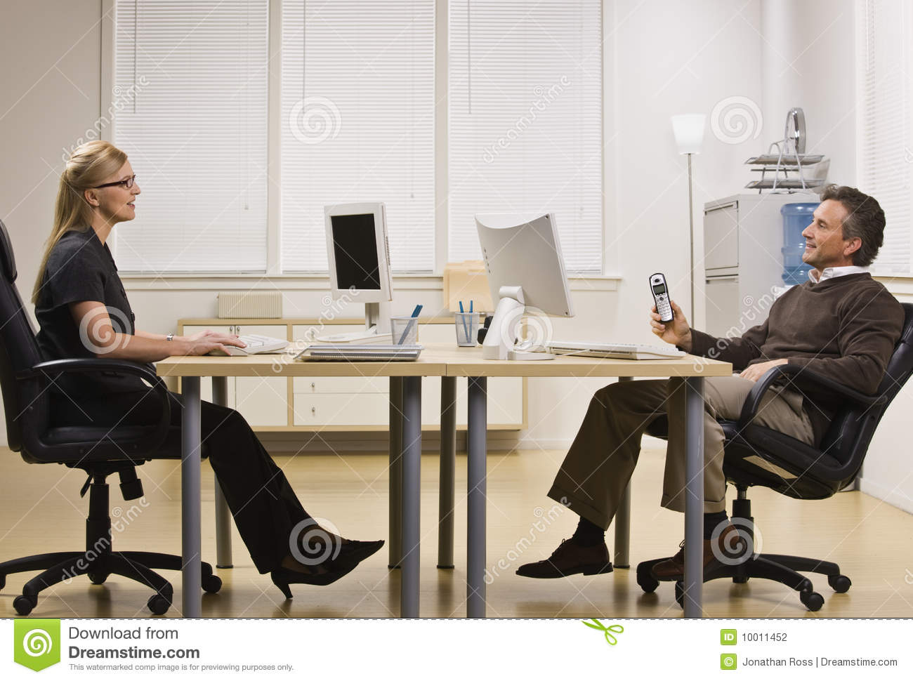 Man and Woman Chatting in Office