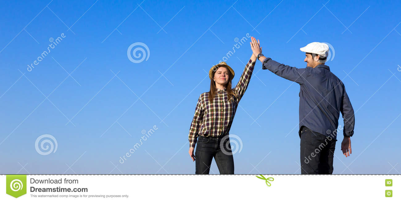 Man and Woman Clapping Hands Each Other