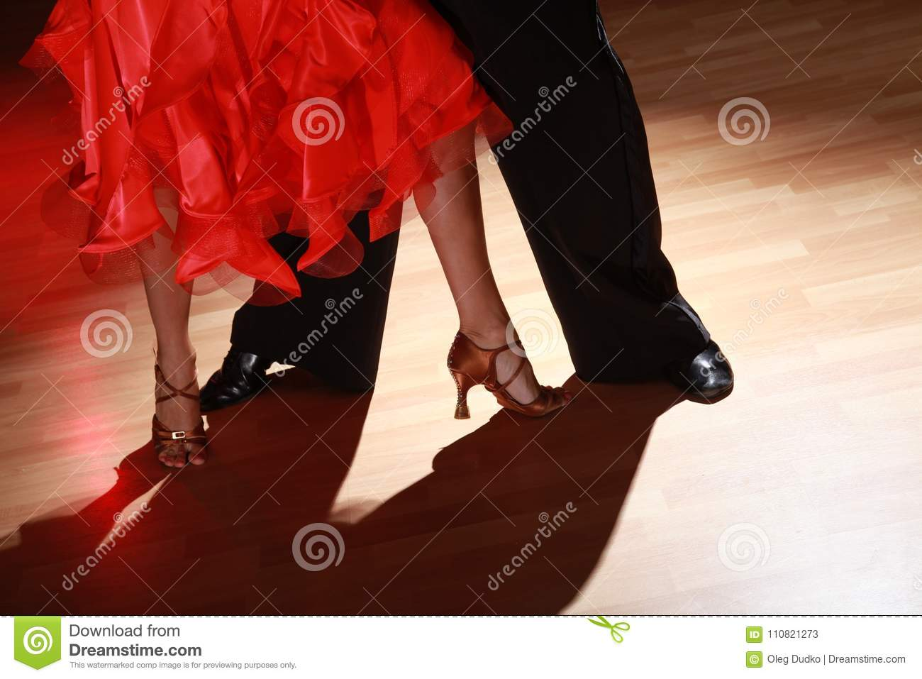 Man and woman dancing Salsa on dark background