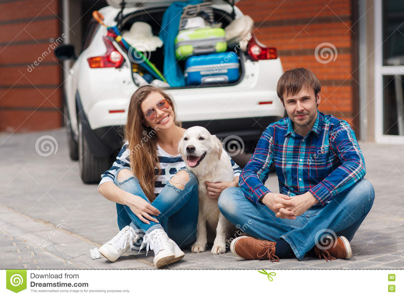 The man and woman with dog by car ready for car trip