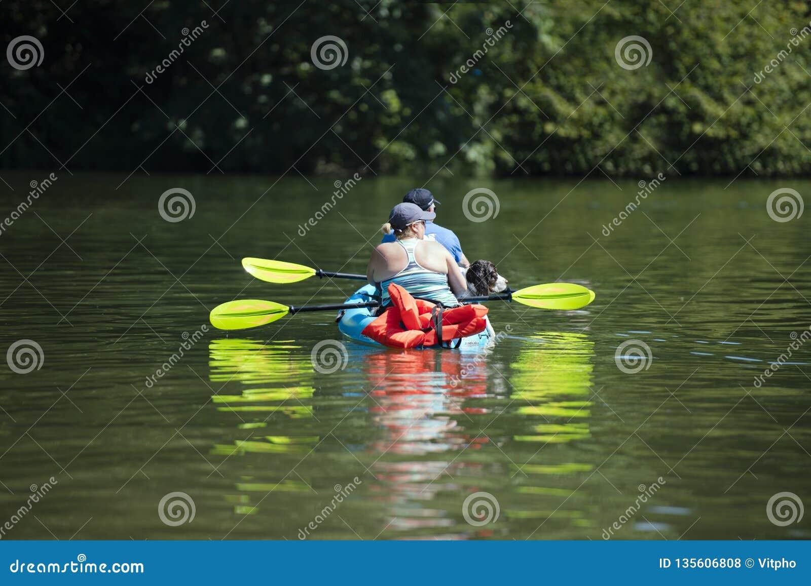 Man Woman And Dog Rowing On Kayak On Quiet Lacamas Lake