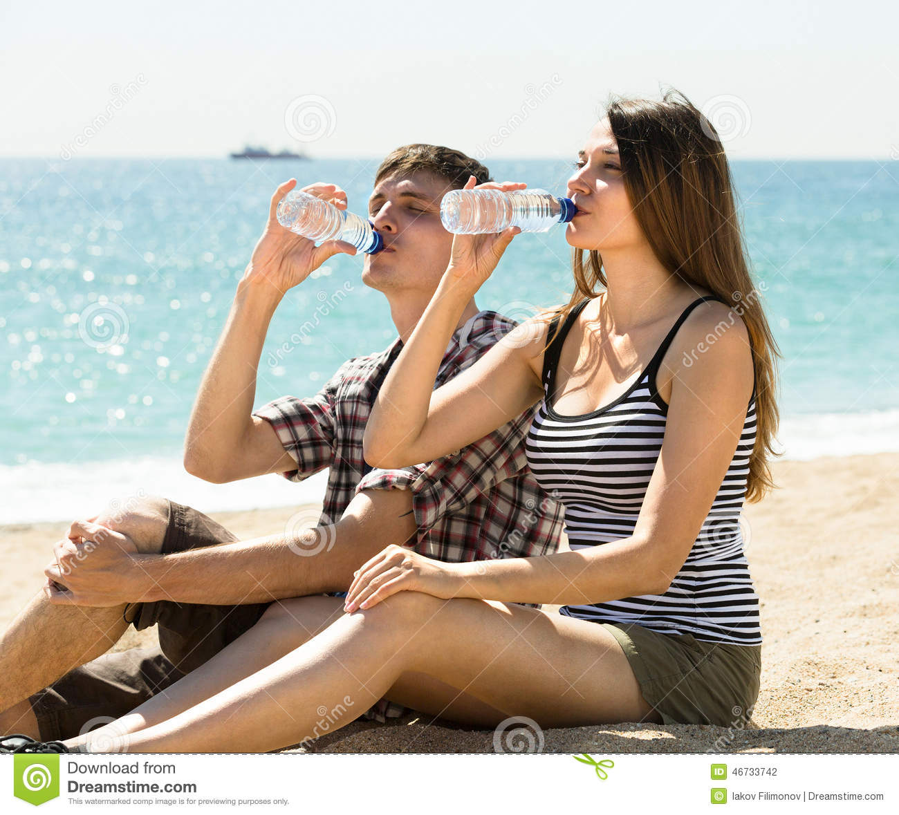 Man and woman drinking bottled water stock photo image of happy man and woman drinking bottled water sciox Gallery