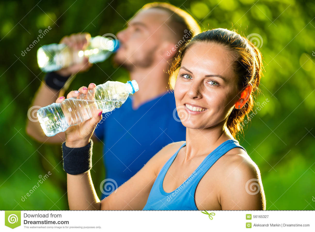 Man And Woman Drinking Water From Bottle After Stock Image Image