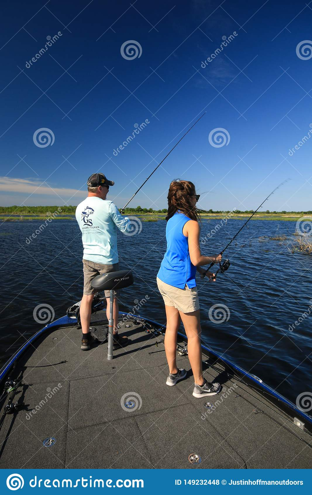 Man and Woman Large Mouth Bass Fishing in Boat
