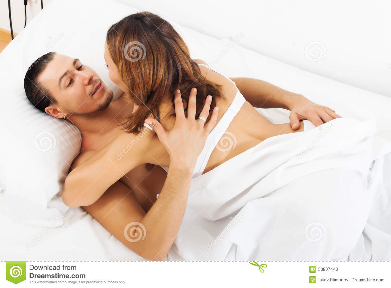 Woman and man having sex