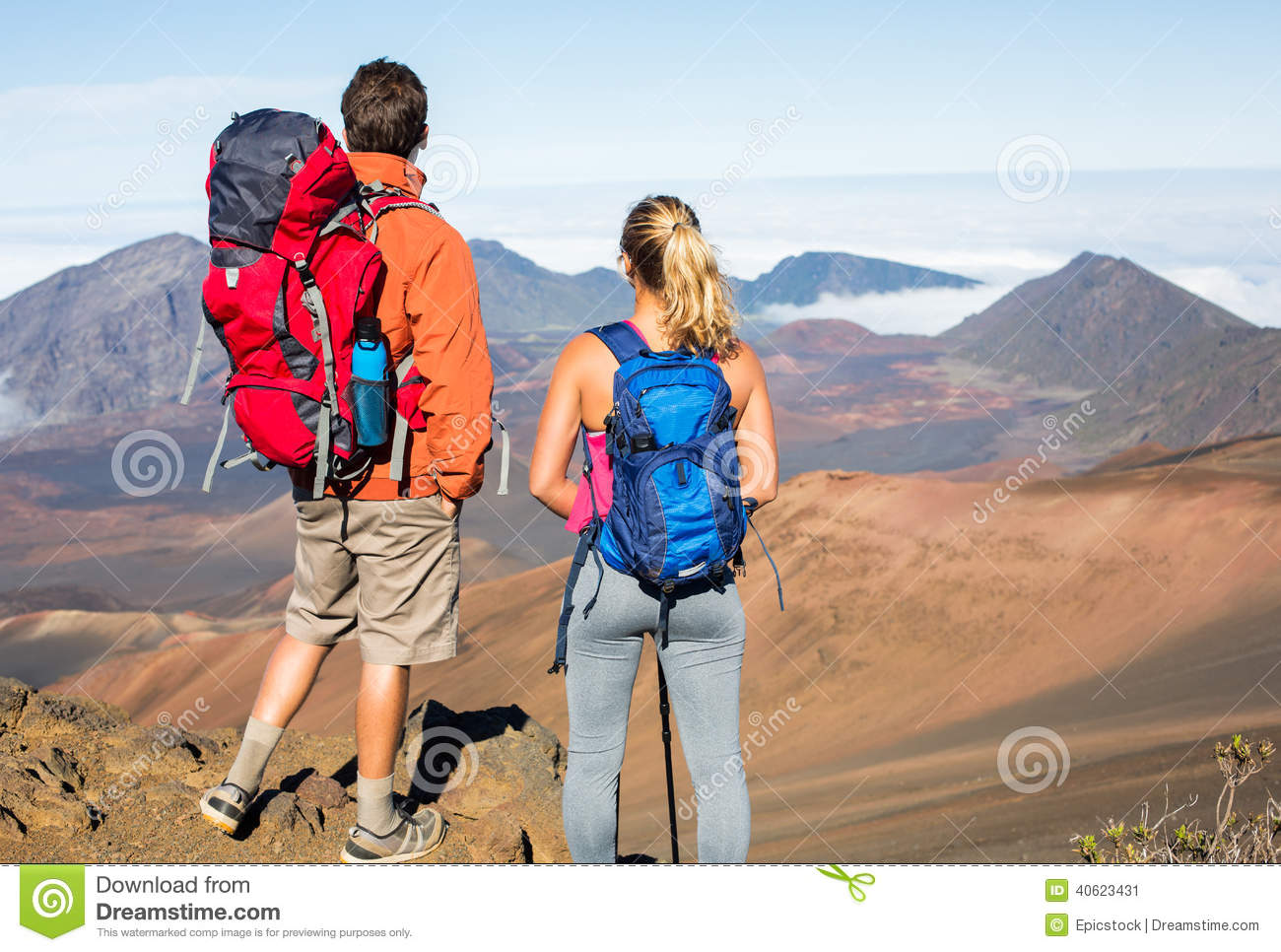 2e16b469dffe96 Man and women hiking on beautiful mountain trail. Trekking and backpacking  in the mountains. Healthy lifestyle outdoor adventure concept.
