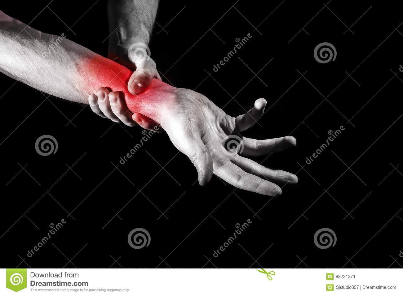 A man, a woman holding her painful wrist, experiencing pain, a