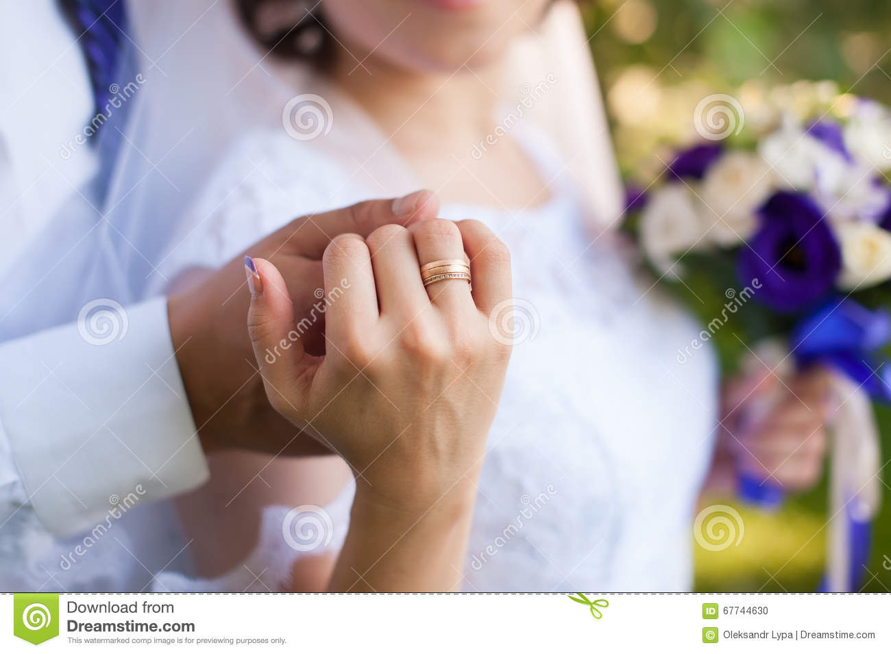 Man and woman hugging, holding hands with ring