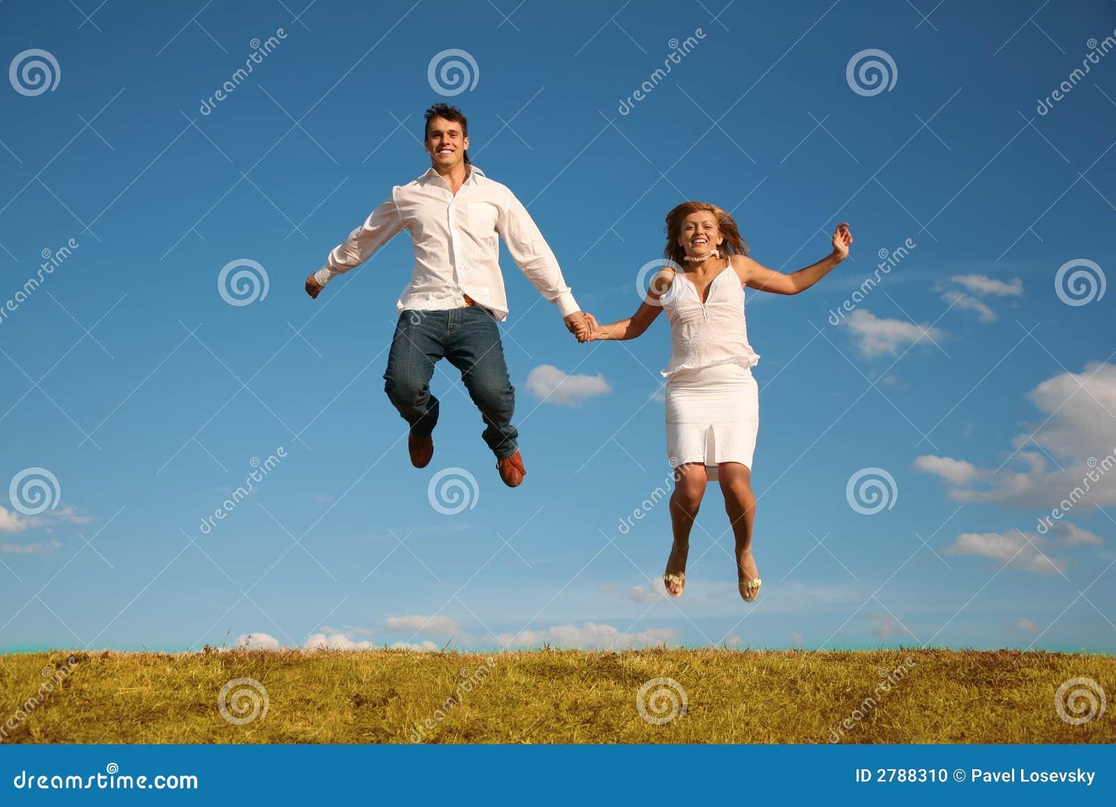 Man and woman jumping