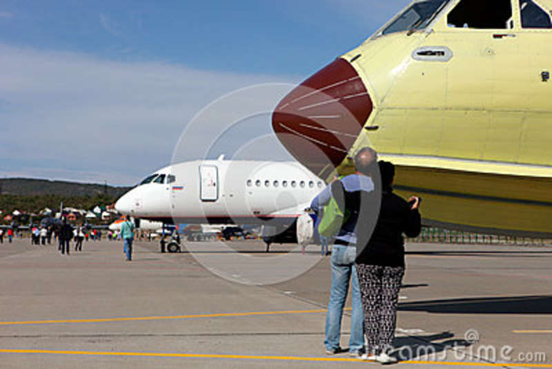 Man And Woman Looking At Planes In The Exhibition Of